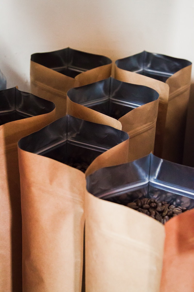 Bags of freshly-roasted, whole bean coffee at Wilson Coffee in Costa Mesa, California.