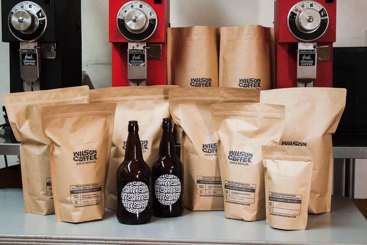 Bags of freshly roasted whole bean coffee, and bottles of cold-brew coffee, at Wilson Coffee in Costa Mesa, California.