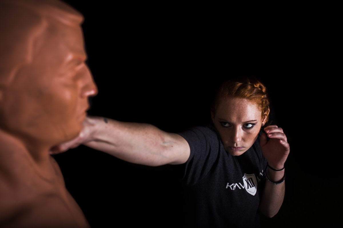Krav Maga XD Instructor, Brooke Evans, demonstrates how to punch. // photo: @byoungforeverphotog