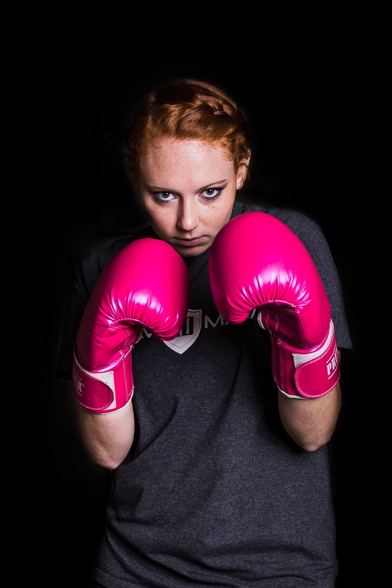 Krav Maga XD instructor, Brooke Evans, in pink boxing gloves. // photo: @byoungforeverphotog