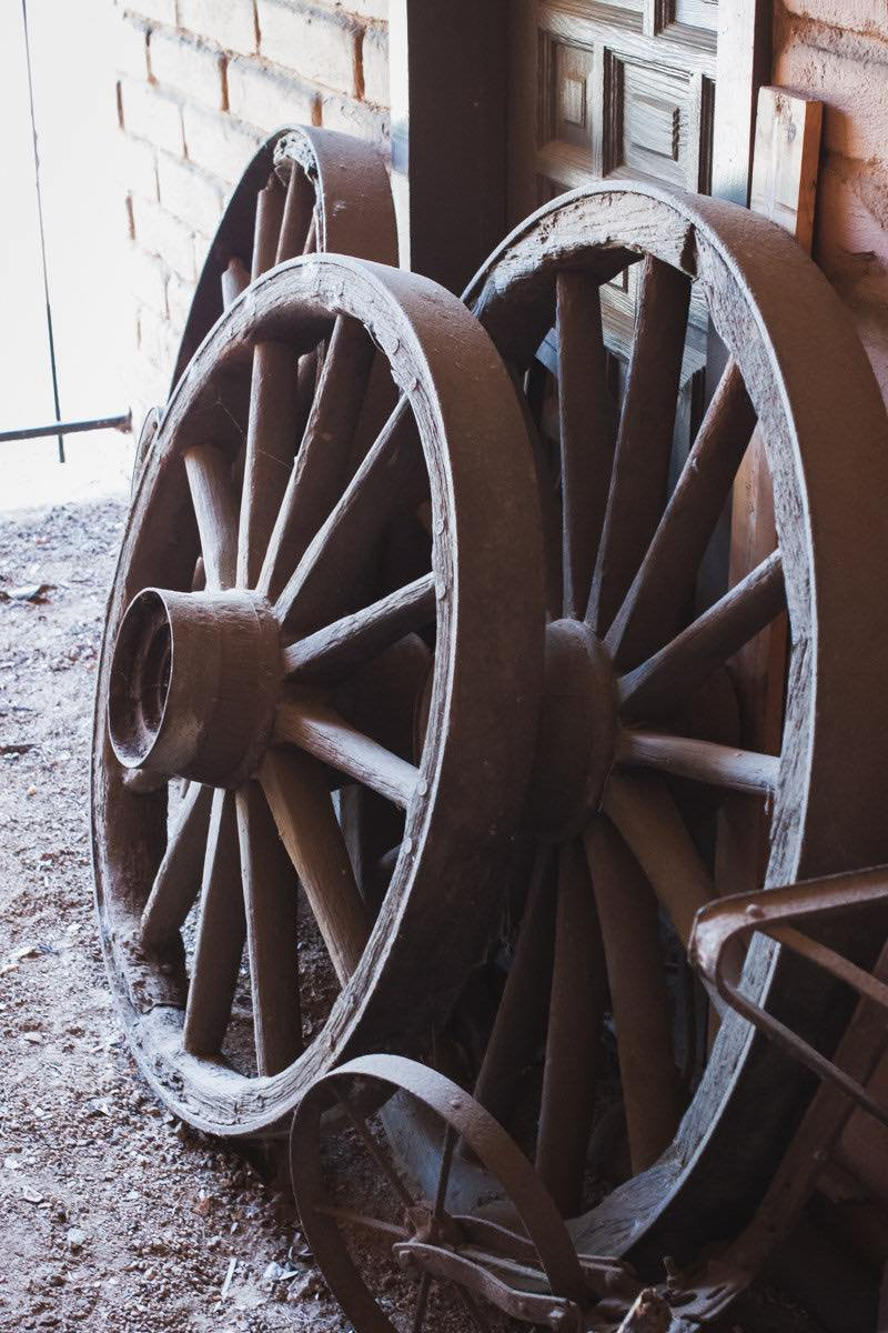 Wooden Wagon Wheels Lean Against A Door At The Diego Sepulveda Adobe At Estancia Park In Costa Mesa, California