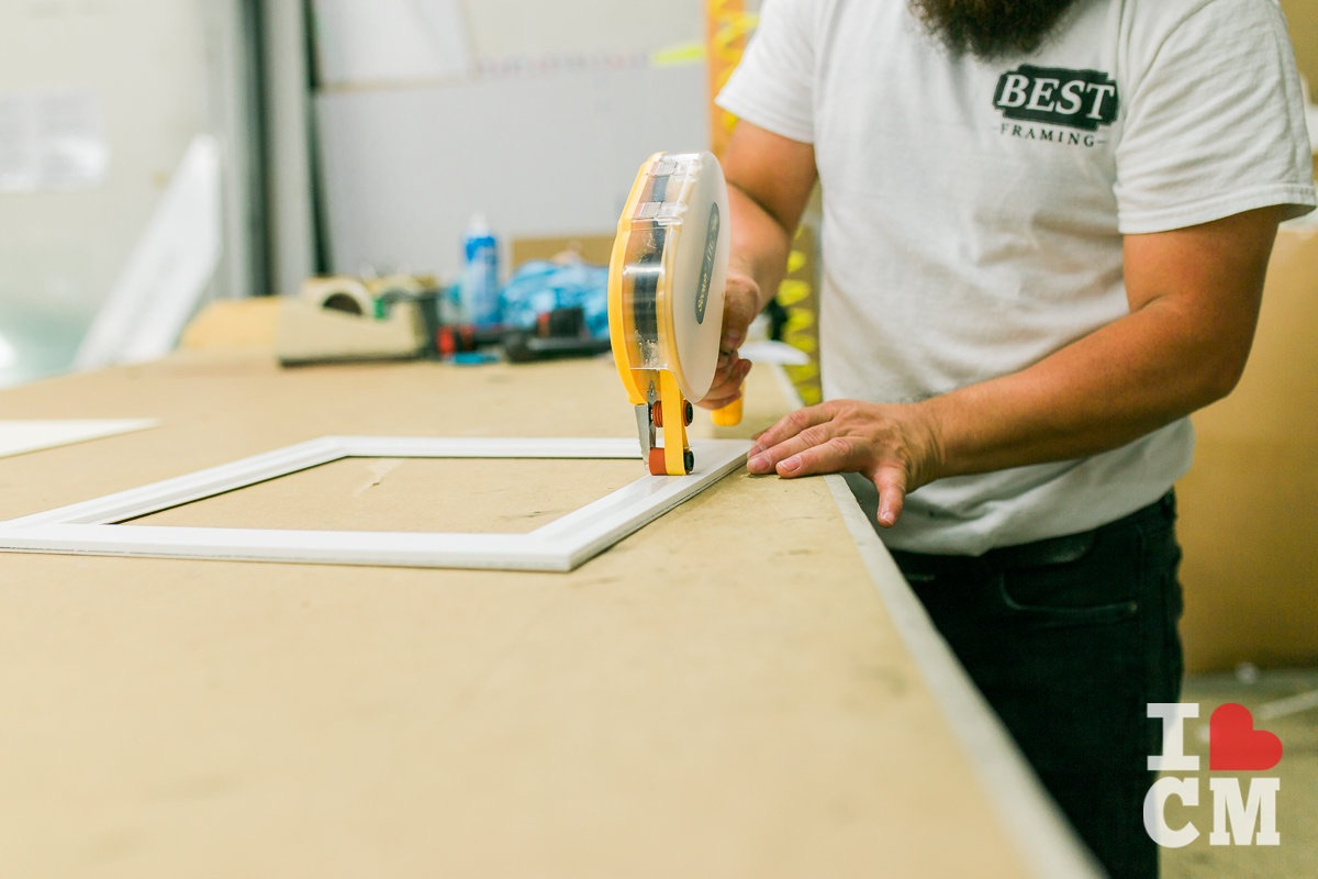 Adding Adhesive at Best Framing in Westside Costa Mesa, California
