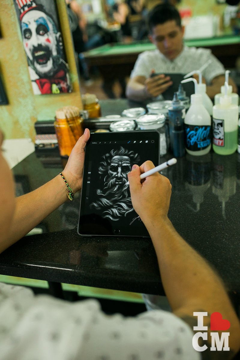Tattoo Artist, Zodel Pedroza, Sketches a Design at Blue Collar Tattoo, Costa Mesa in Orange County, California