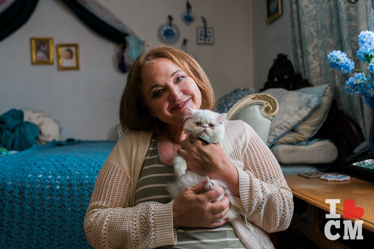 Founder and CEO of Project Cuddle, Debbe Magnusen - and her kitten, Blue - in Costa Mesa, California