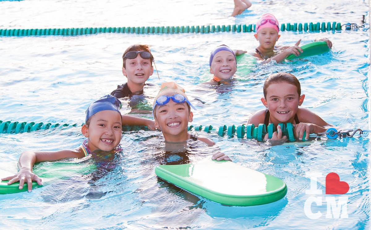 Smiling Kids in the Pool at the Costa Mesa Aquatics Club (CMAC) in Orange County, California