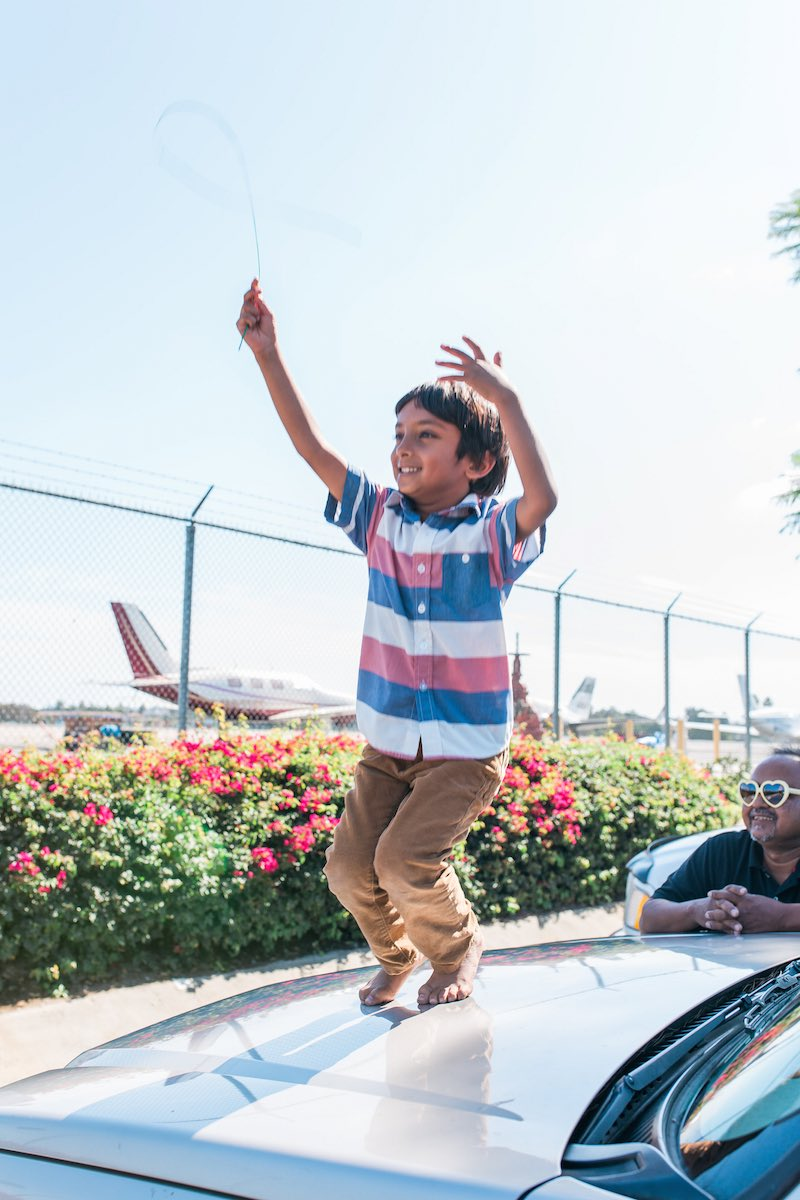 Abu Zubair, with his son, Zarrar, watching planes take off at John Wayne Airport. (Costa Mesa, CA)