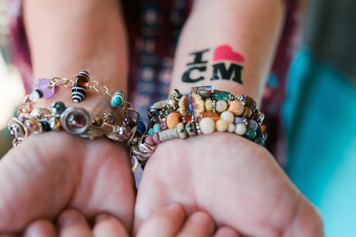Jewelry-maker Stacey Peterson shows off her beautiful handiwork (along with a little love for Costa Mesa) at The Camp in Orange County.
