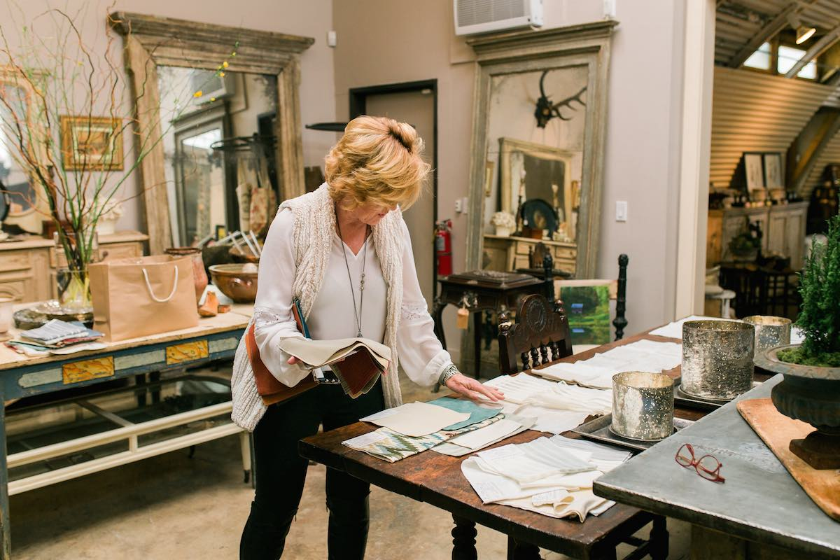 Katherine Shakas Sorts Through Swatches At The French Container Antiques Boutique and Interior Design Studio in Costa Mesa