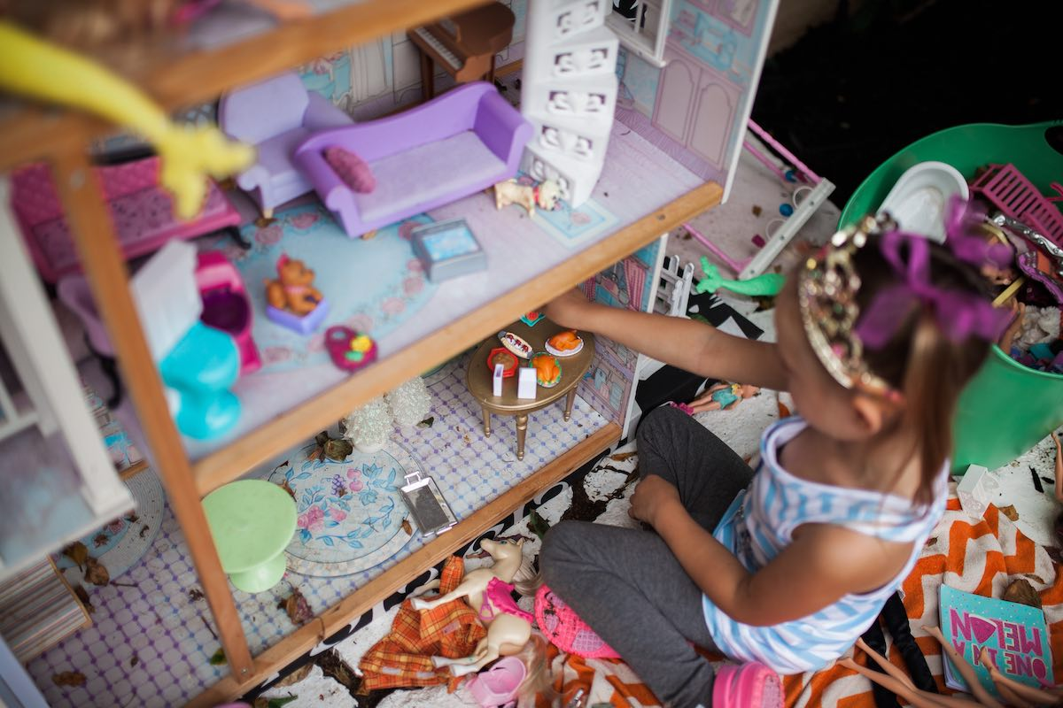Girl in a Princess Crown playing with Dolls and a Dollhouse at Camp Lila, Mesa del Mar Costa Mesa