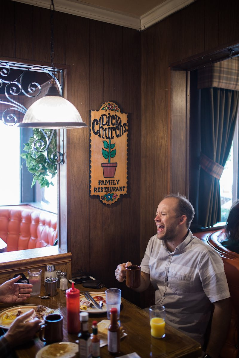 A customer laughs over breakfast and coffee at Dick Church's Restaurant in Eastside Costa Mesa, California