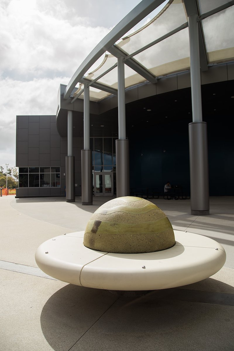 "Sit and ponder the universe on the ""rings of Saturn"" bench outside the OCC Planetarium in Costa Mesa, Orange County, California. (photo: Brandy Young)"
