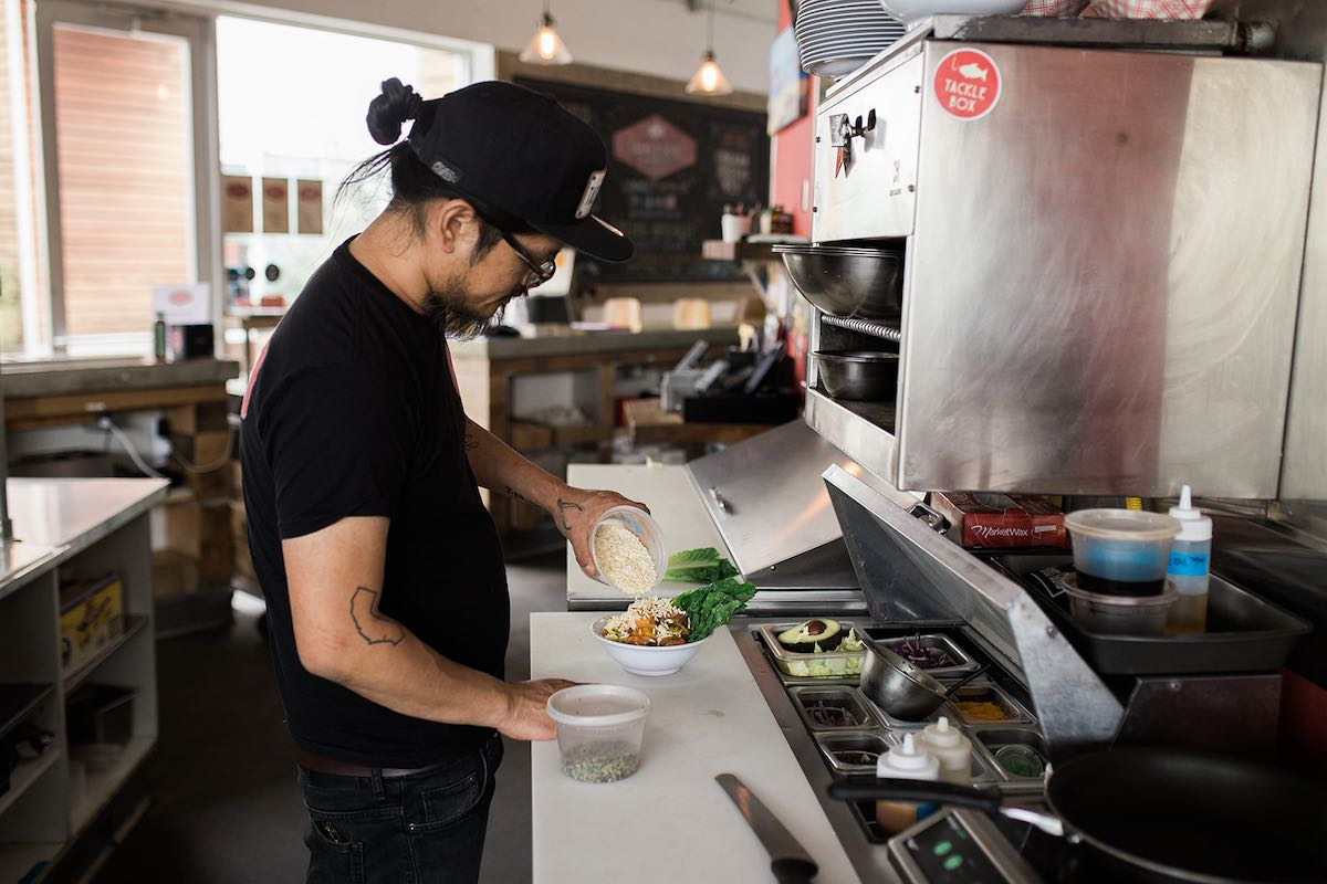 Top Chef, Brina Huskey, prepares a poke bowl in the kitchen of his restaurant / pub, Tackle Box, at SOCO and The OC Mix in Costa Mesa, Orange County, California.